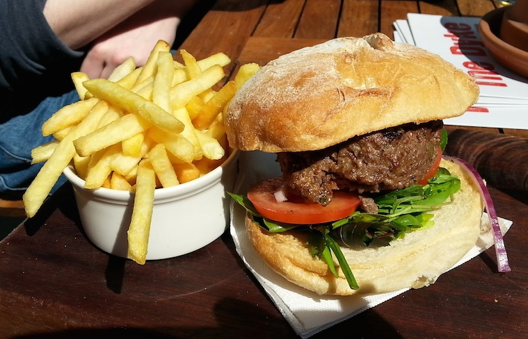 The burger and some fries from the Dyke. We were outside so it's sunny.