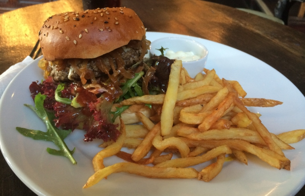 The Temple Bar's burger and fries. Fries are on a plate not in a bowl as they should be!